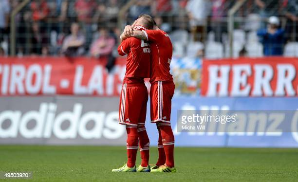 David Vrzogic and Tobias Schweinsteiger of Muenchen regret their teams defeat in the second relegation leg between Bayern Muenchen II and Fortuna...