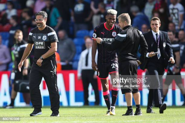 David Wagner head coach / manager of Huddersfield Town and Christophe Buhler assistant head coach of Huddersfield Town share a joke with Steve Mounie...