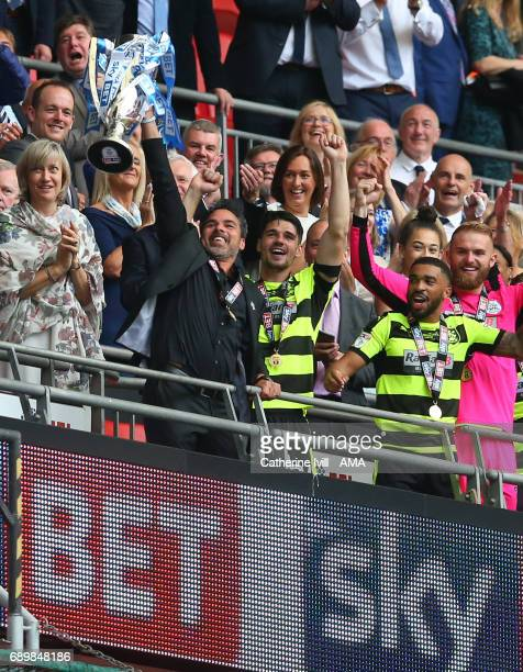 David Wagner head coach / manager of Huddersfield Town and Christopher Schindler of Huddersfield Town lift the trophy after the Sky Bet Championship...