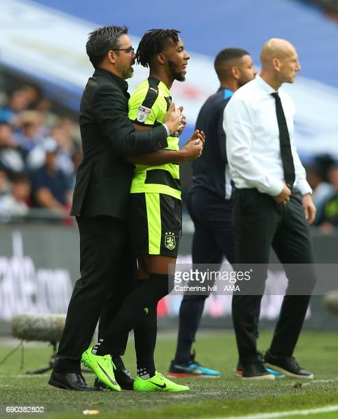 David Wagner head coach / manager of Huddersfield Town and Kasey Palmer of Huddersfield Town during the Sky Bet Championship Play Off Final match...