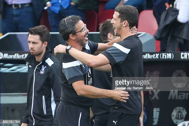 David Wagner head coach / manager of Huddersfield Town and Mark Hudson of Huddersfield Town celebrate at full time during the Premier League match...