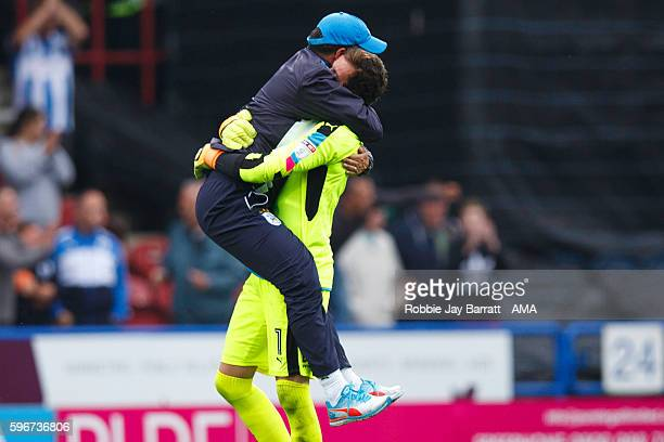David Wagner head coach / manager of Huddersfield Town celebrates with Goalkeeper Danny Ward of Huddersfield Town at full time during the Sky Bet...