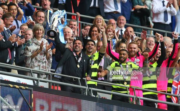David Wagner head coach / manager of Huddersfield Town celebrates promotion with the trophy after the Sky Bet Championship Play Off Final match...