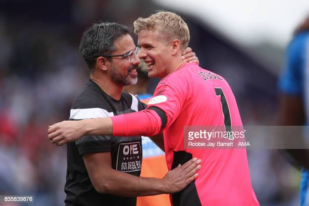 David Wagner head coach / manager of Huddersfield Town celebrates with Jonas Lossl of Huddersfield Town at full time during the Premier League match...