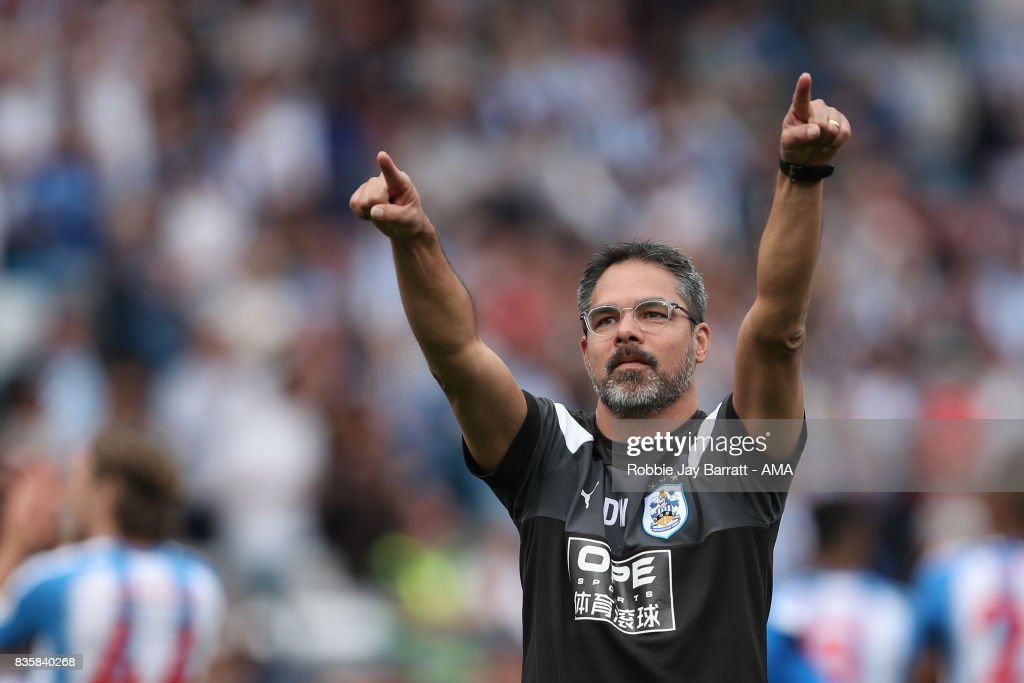 David Wagner head coach / manager of Huddersfield Town celebrates with the fans at full time during the Premier League match between Huddersfield Town and Newcastle United at Galpharm Stadium on August 20, 2017 in Huddersfield, England.