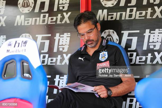David Wagner head coach / manager of Huddersfield Town reads the match day programme prior to the Premier League match between Crystal Palace and...