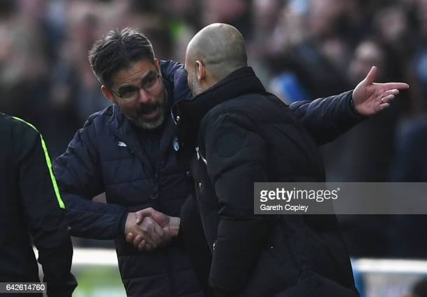 David Wagner Manager of Huddersfield Town and Josep Guardiola Manager of Manchester City embrace after The Emirates FA Cup Fifth Round match between...