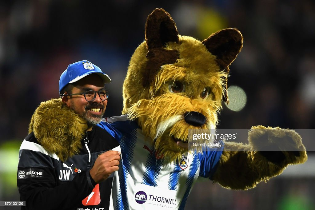 David Wagner, Manager of Huddersfield Town celebrates with mascot Terry The Terrier after the Premier League match between Huddersfield Town and West Bromwich Albion at John Smith's Stadium on November 4, 2017 in Huddersfield, England.