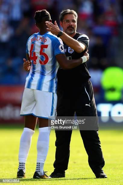 David Wagner Manager of Huddersfield Town hugs Kasey Palmer of Huddersfield Town after the Premier League match between Huddersfield Town and...
