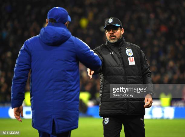 David Wagner Manager of Huddersfield Town shakes hands with Antonio Conte Manager of Chelsea after the Premier League match between Huddersfield Town...