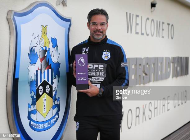 David Wagner of Huddersfield Town poses with the Barclays Manager of the Month Award for August 2017 September 7 2017 in Huddersfield England