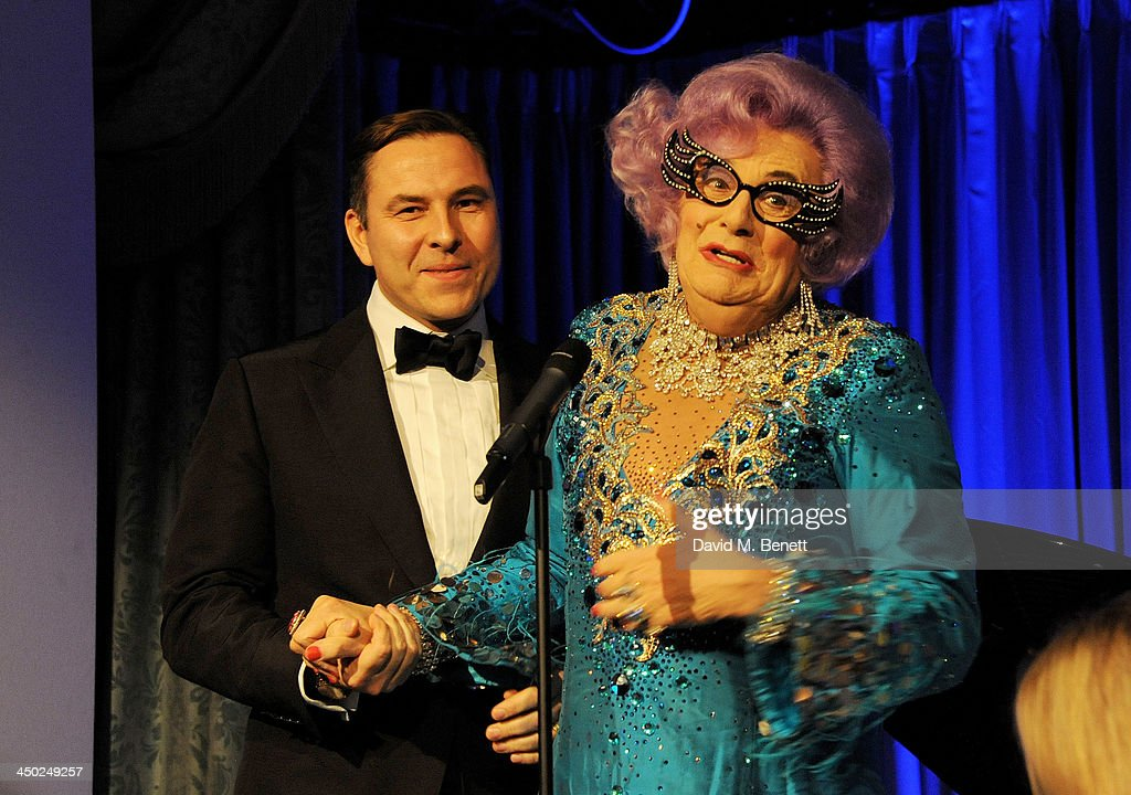 David Walliams (L) accepts the Award For Comedy from Dame Edna Everage at the 59th London Evening Standard Theatre Awards at The Savoy Hotel on November 17, 2013 in London, England.