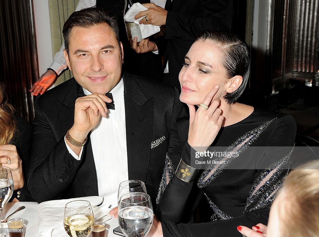 (MANDATORY CREDIT PHOTO BY DAVE M BENETT/GETTY IMAGES REQUIRED) David Walliams (L) and Erin O'Connor attend the Harper's Bazaar Women of the Year Awards 2012, in association with Estee Lauder, Harrods and Tiffany & Co., at Claridge's Hotel on October 31, 2012 in London, England.