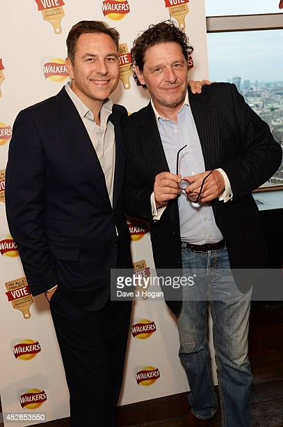 David Walliams and Marco Pierre White attend the Walkers 'Do Us A Flavour' finalists launch at Centrepoint on July 28 2014 in London England