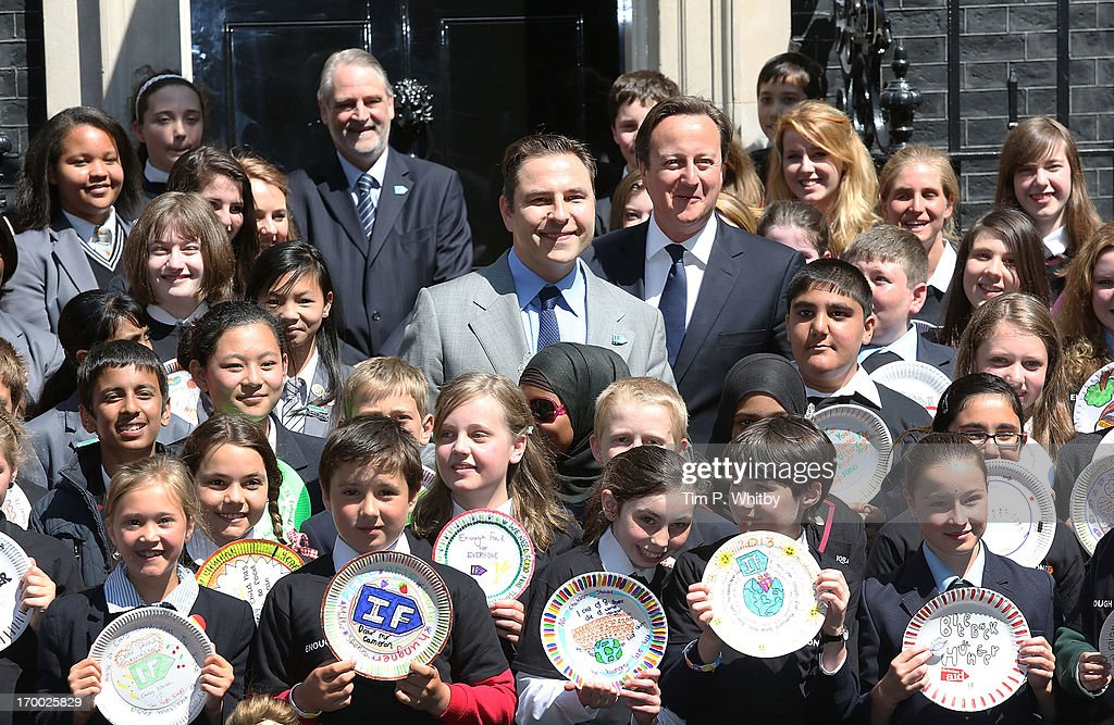 <a gi-track='captionPersonalityLinkClicked' href=/galleries/search?phrase=David+Walliams&family=editorial&specificpeople=203020 ng-click='$event.stopPropagation()'>David Walliams</a> and Prime Minister <a gi-track='captionPersonalityLinkClicked' href=/galleries/search?phrase=David+Cameron+-+Politician&family=editorial&specificpeople=227076 ng-click='$event.stopPropagation()'>David Cameron</a> lead 100 school children to appeal for an end to Global hunger at 10 Downing Street on June 6, 2013 in London, England. <a gi-track='captionPersonalityLinkClicked' href=/galleries/search?phrase=David+Walliams&family=editorial&specificpeople=203020 ng-click='$event.stopPropagation()'>David Walliams</a> and children from schools across England and Wales presented decorated plates to No 10 in support of the 'Enough Food For Everyone IF' campaign. The Big IF London event will take place in Hyde Park on 8 June, 2013.