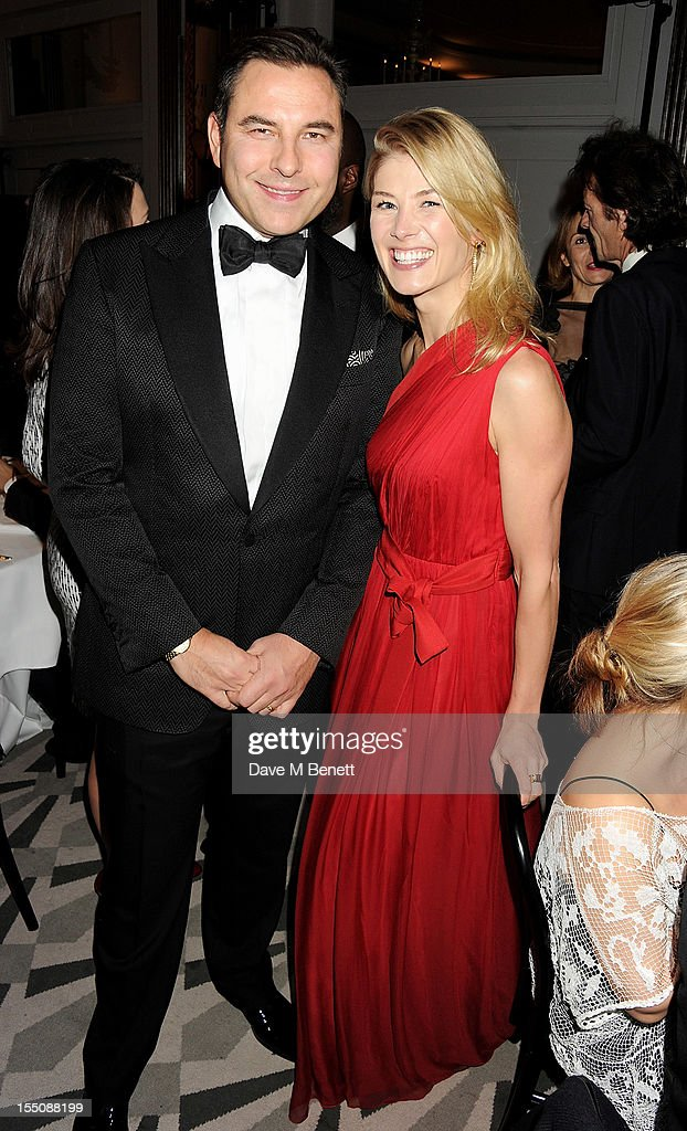 (MANDATORY CREDIT PHOTO BY DAVE M BENETT/GETTY IMAGES REQUIRED) David Walliams (L) and Rosamund Pike attend the Harper's Bazaar Women of the Year Awards 2012, in association with Estee Lauder, Harrods and Tiffany & Co., at Claridge's Hotel on October 31, 2012 in London, England.