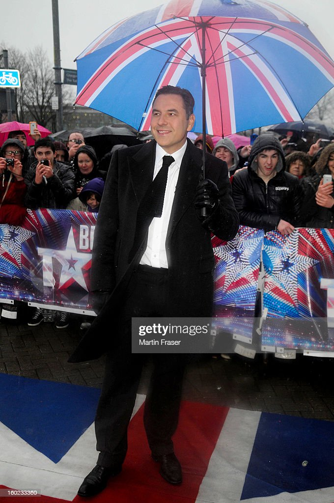David Walliams arrives at the very wet Glasgow auditions for Britain's Got Talent, under a Union Jack umbrella, at Clyde Theatre on January 28, 2013 in Glasgow, Scotland.