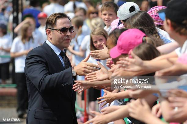 David Walliams meets school children during a visit to College House Junior School where the Hollywood actress Kate Beckinsale unveiled a plaque in...