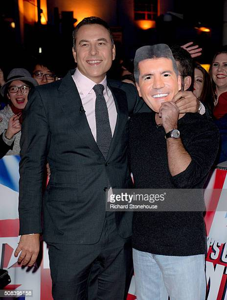 David Walliams puts a Simon Cowell Mask in front of Simon's face as they arrive at the Birmingham audtions for Britain's Got Talent at Birmingham...