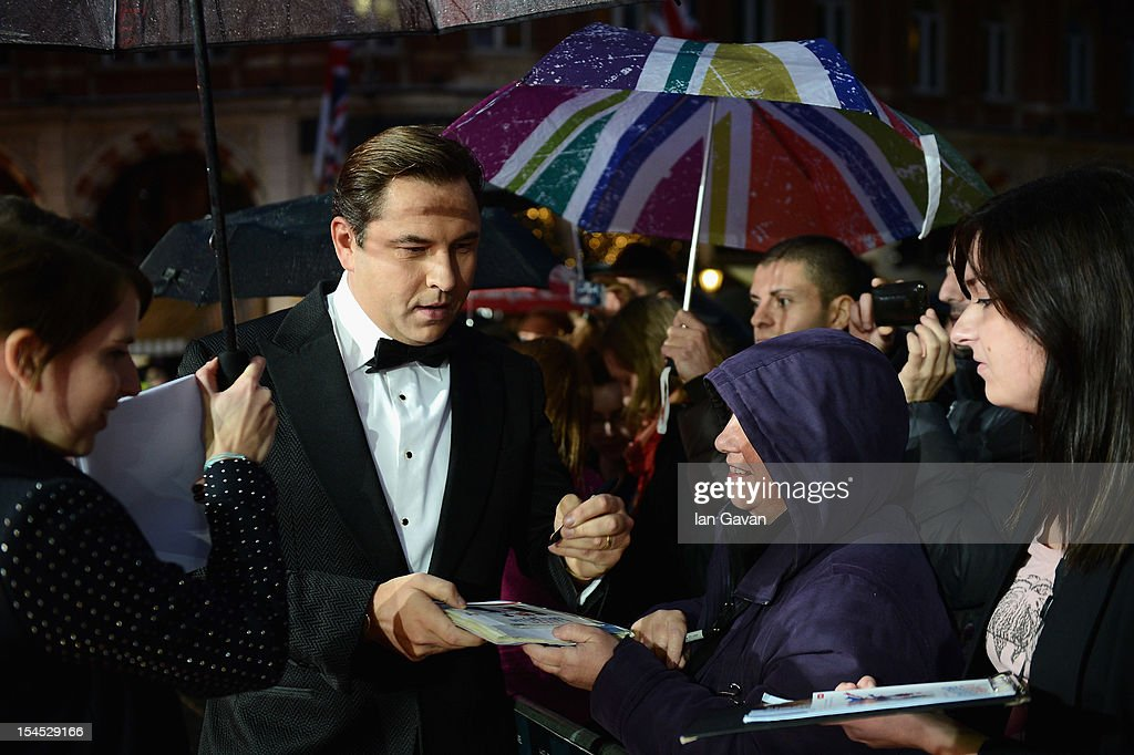 <a gi-track='captionPersonalityLinkClicked' href=/galleries/search?phrase=David+Walliams&family=editorial&specificpeople=203020 ng-click='$event.stopPropagation()'>David Walliams</a> signs autographs at the Closing Night Gala of 'Great Expectations' during the 56th BFI London Film Festival at Odeon Leicester Square on October 21, 2012 in London, England.