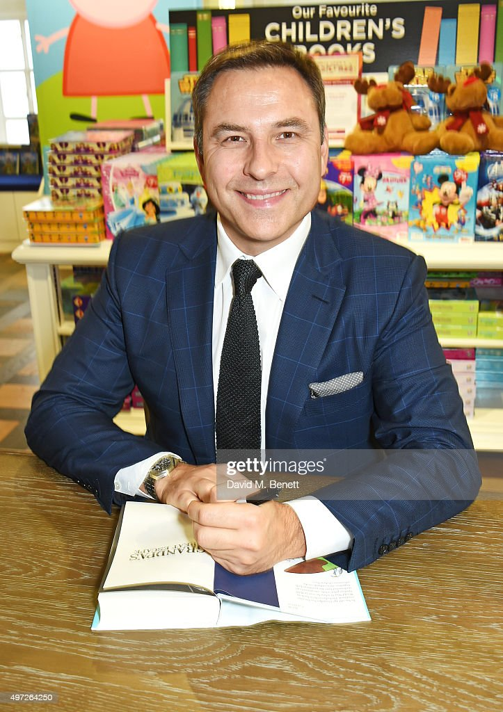<a gi-track='captionPersonalityLinkClicked' href=/galleries/search?phrase=David+Walliams&family=editorial&specificpeople=203020 ng-click='$event.stopPropagation()'>David Walliams</a> signs copies of his books 'Grandpa's Great Escape' and 'The Bear Who Went Boo' at Harrods on November 15, 2015 in London, England.