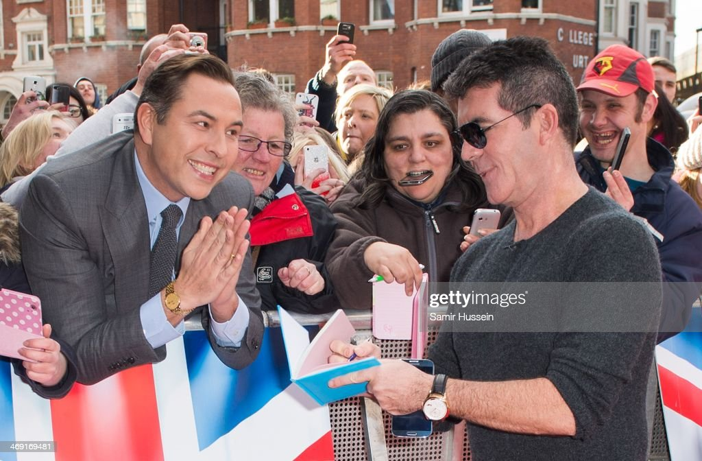 <a gi-track='captionPersonalityLinkClicked' href=/galleries/search?phrase=David+Walliams&family=editorial&specificpeople=203020 ng-click='$event.stopPropagation()'>David Walliams</a> stands in the crowd and gets an autograph from <a gi-track='captionPersonalityLinkClicked' href=/galleries/search?phrase=Simon+Cowell&family=editorial&specificpeople=203007 ng-click='$event.stopPropagation()'>Simon Cowell</a> (R) at the the Britain's Got Talent London auditions at the Hammersmith Apollo on February 13, 2014 in London, England.