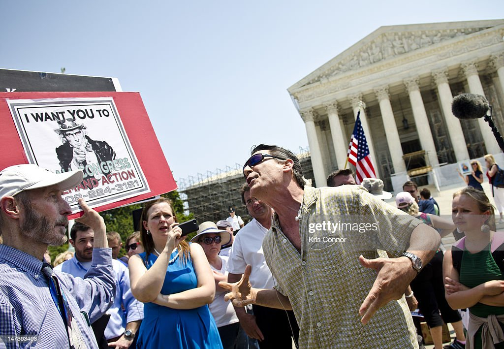 David Walls-Kaufman argues with a another protester about the Affordable Healthcare Act outside the U.S. Supreme Court on June 28, 2012 in Washington, DC. The Court found the law to be constitutional and did not strike down any part of it.