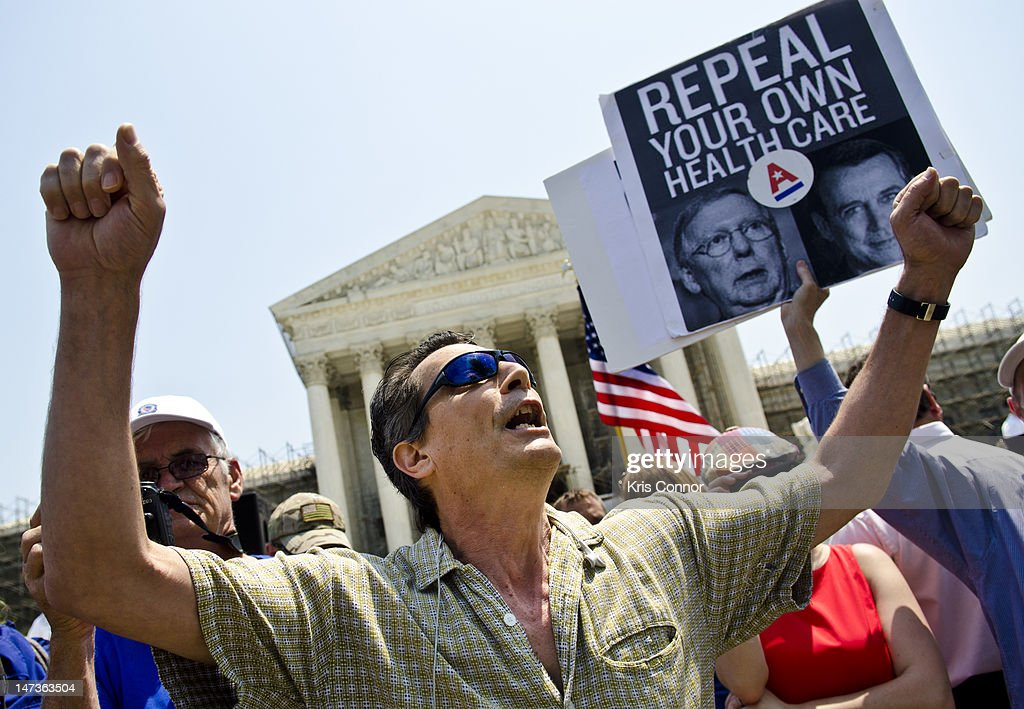 David Walls-Kaufman yells outside the U.S. Supreme Court on June 28, 2012 in Washington, DC. The Court found the Affordable Healthcare Act to be constitutional and did not strike down any part of it.
