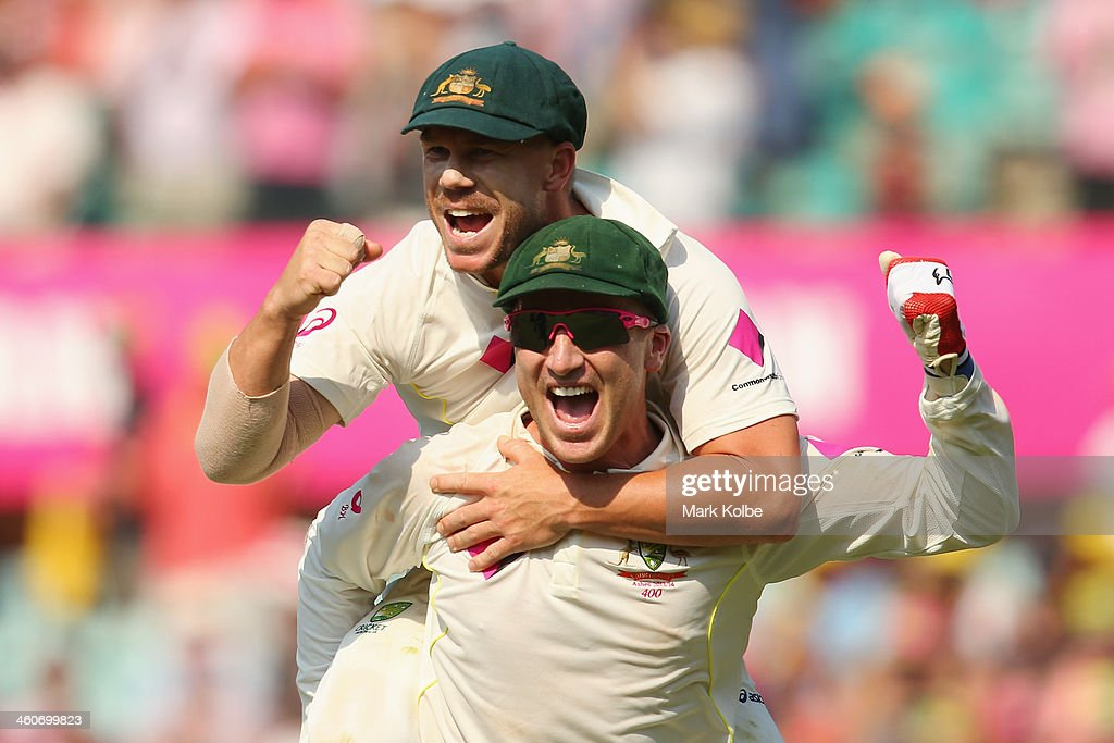 David Warner and Brad Haddin of Australia celebrate victory during day three of the Fifth Ashes Test match between Australia and England at Sydney Cricket Ground on January 5, 2014 in Sydney, Australia.