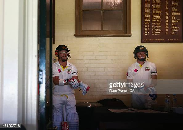 David Warner and Chris Rogers of Australia prepare to walk out to bat during day four of the Fourth Test match between Australia and India at Sydney...