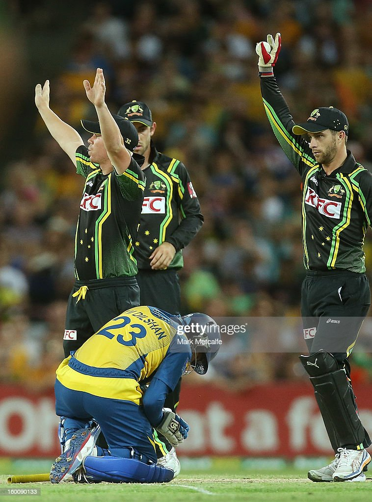 David Warner and Matthew wade of Australia call for assistance for <a gi-track='captionPersonalityLinkClicked' href=/galleries/search?phrase=Tillakaratne+Dilshan&family=editorial&specificpeople=239186 ng-click='$event.stopPropagation()'>Tillakaratne Dilshan</a> of Sri Lanka after he was struck in the head by the ball off the bowling of Ben Laughlin during game one of the Twenty20 international match between Australia and Sri Lanka at ANZ Stadium on January 26, 2013 in Sydney, Australia.