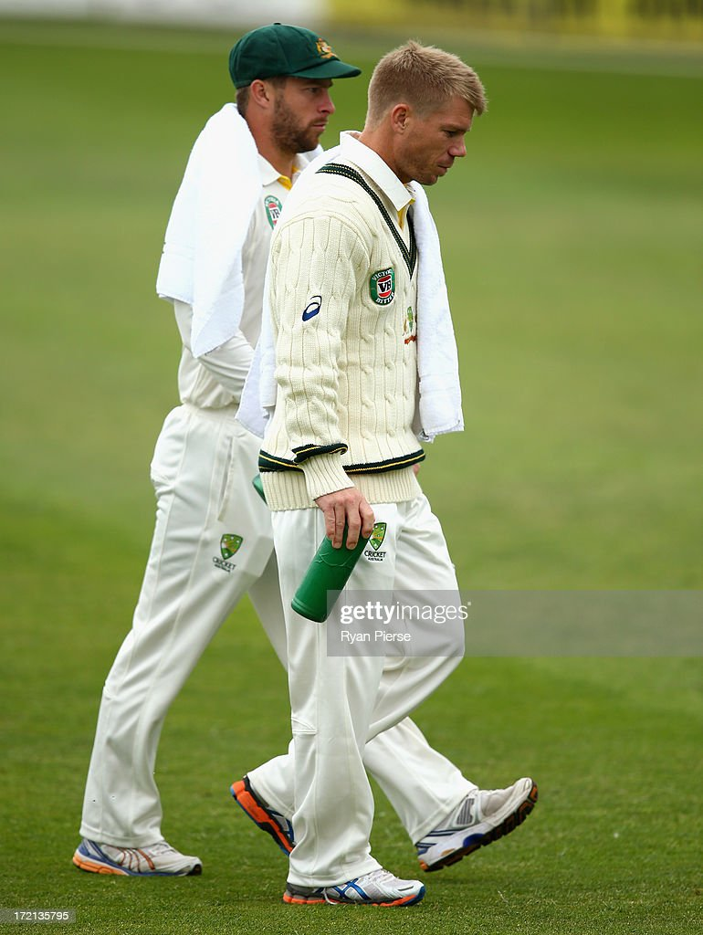 David Warner and Matthew Wade of Australia run drinks to the batsmen during day one of the Tour Match between Worcestershire and Australia at New Road on July 2, 2013 in Worcester, England.