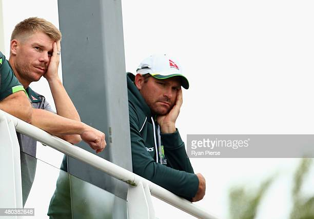 David Warner and Ryan Harris of Australia look on after day four of the 1st Investec Ashes Test match between England and Australia at SWALEC Stadium...