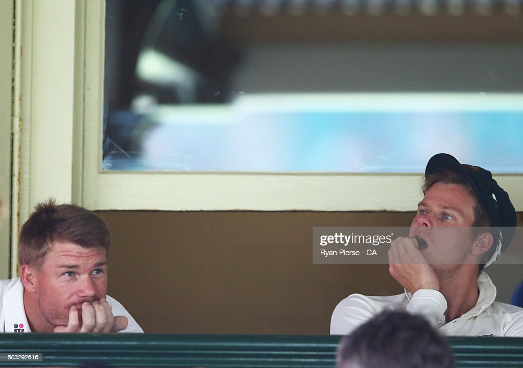 David Warner and Steve Smith of Australia look on as rain delays play during day two of the third Test match between Australia and the West Indies at...