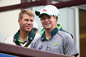David Warner and Steve Smith of Australia look on as rain delays the start of play during day one of tour match between Northamptonshire and...