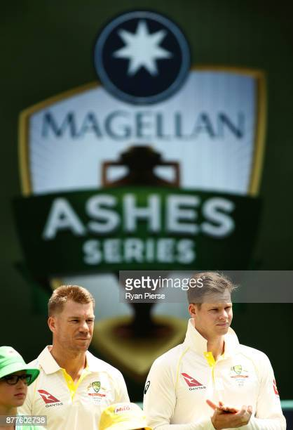 David Warner and Steve Smith of Australia look on during day one of the First Test Match of the 2017/18 Ashes Series between Australia and England at...