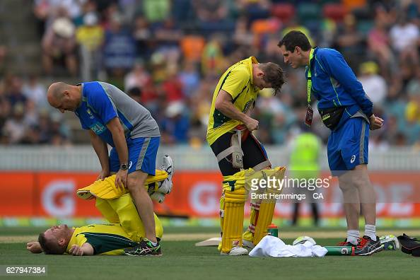 David Warner and Steve Smith of Australia receive treatment on the field during game two of the One Day International series between Australia and...