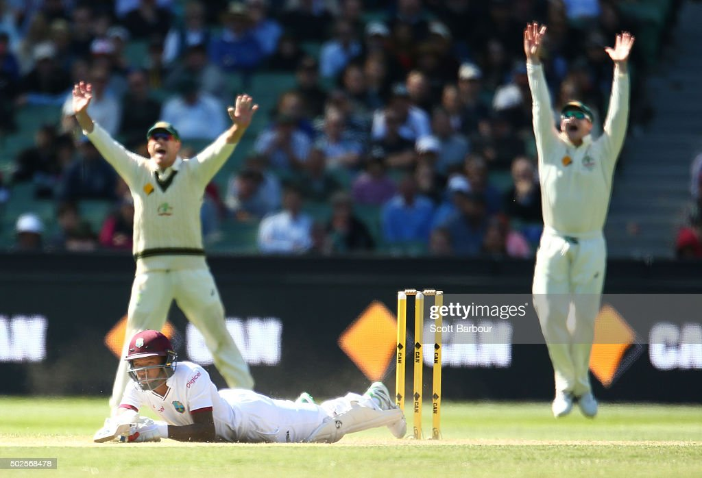<a gi-track='captionPersonalityLinkClicked' href=/galleries/search?phrase=David+Warner+-+Cricket+Player&family=editorial&specificpeople=4262255 ng-click='$event.stopPropagation()'>David Warner</a> and Steven Smith of Australia appeal as Jermaine Blackwood of the West Indies falls over after almost being bowled by a yorker bowled by James Pattinson of Australia during day two of the Second Test match between Australia and the West Indies at the Melbourne Cricket Ground on December 27, 2015 in Melbourne, Australia.