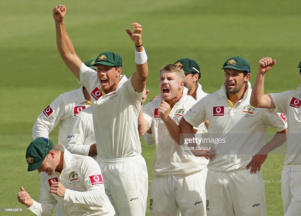 David Warner and the Australian team celebrate as the third umpire confirms the dismissal of Hashim Amla of South Africa during day two of the Second Test match between Australia and South Africa at Adelaide Oval on November 23, 2012 in Adelaide, Australia.