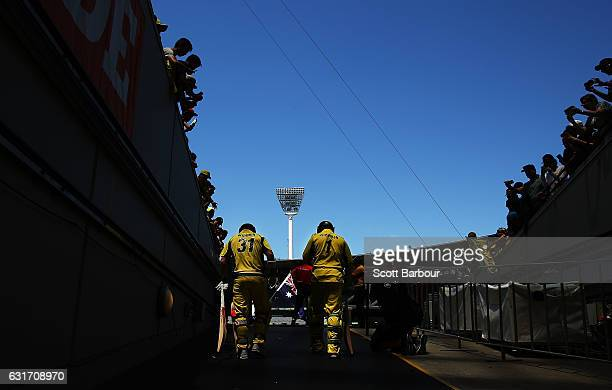 David Warner and Usman Khawaja of Australia walk out to bat during game two of the One Day International series between Australia and Pakistan at...