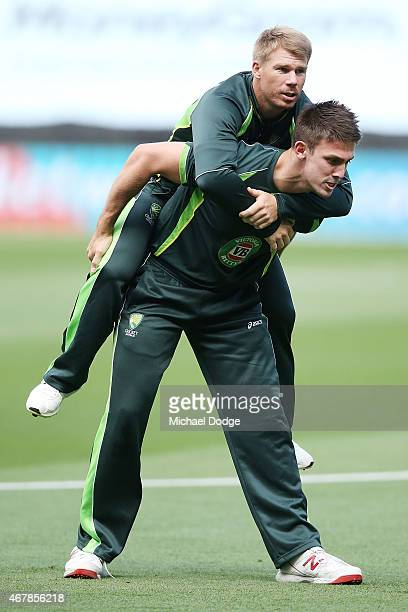 David Warner gets a piggy back from Mitch Marsh during an Australian nets session at Melbourne Cricket Ground on March 28 2015 in Melbourne Australia