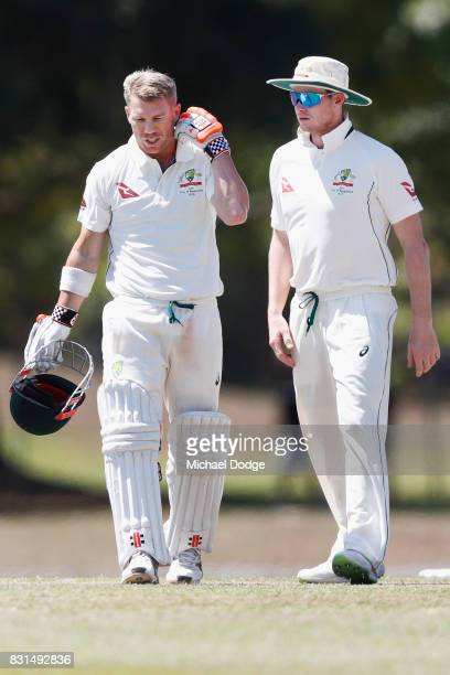 David Warner is attended to by Steve Smith after being hit by a Josh Hazelwood bouncer during day two of the Australian Test cricket intersquad match...