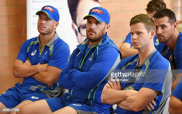 David Warner of Australia Aaron Finch of Australia and Steven Smith of Australia look on during a training session at Gilles Field on January 25 2016...