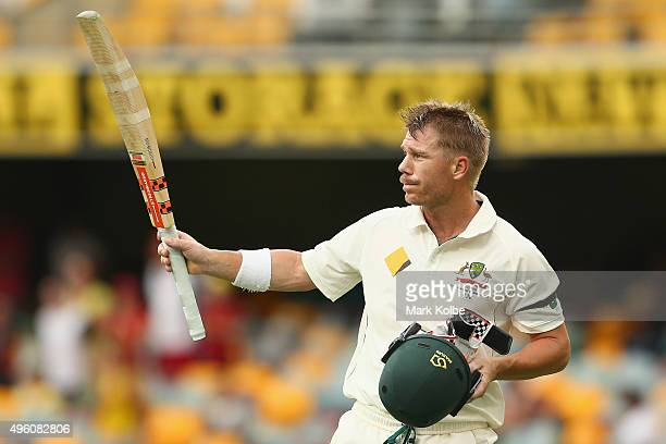 David Warner of Australia acknowledges the crowd as he leaves after being dismissed 116 during day three of the First Test match between Australia...