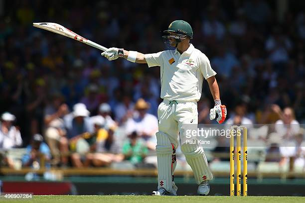 David Warner of Australia acknowledges the dressing rooms after scoring his half century during day one of the second Test match between Australia...