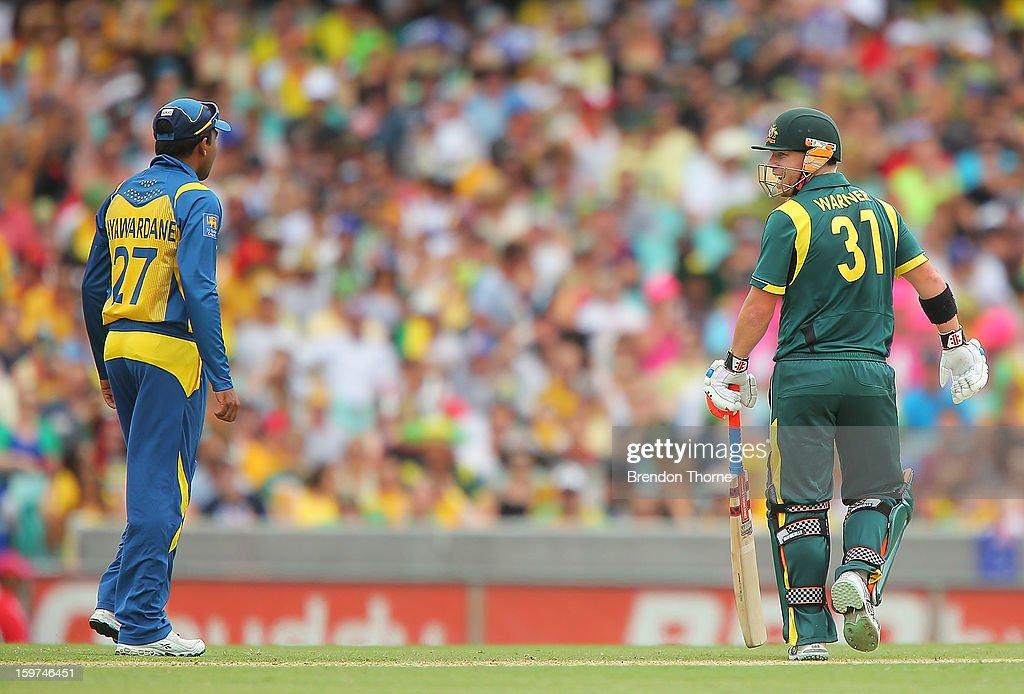 David Warner of Australia and Mahela Jayawardena of Sri Lanka share words during game four of the Commonwealth Bank one day international series between Australia and Sri Lanka at Sydney Cricket Ground on January 20, 2013 in Sydney, Australia.