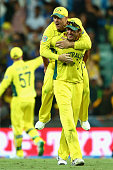 David Warner of Australia and Mitchell Starc of Australia celebrate after winning the 2015 Cricket World Cup Semi Final match between Australia and...