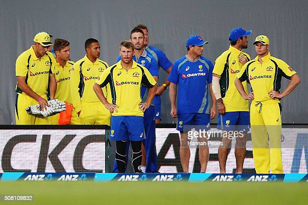 David Warner of Australia and Steve Smith of Australia look on with the team after losing the One Day International match between New Zealand and...