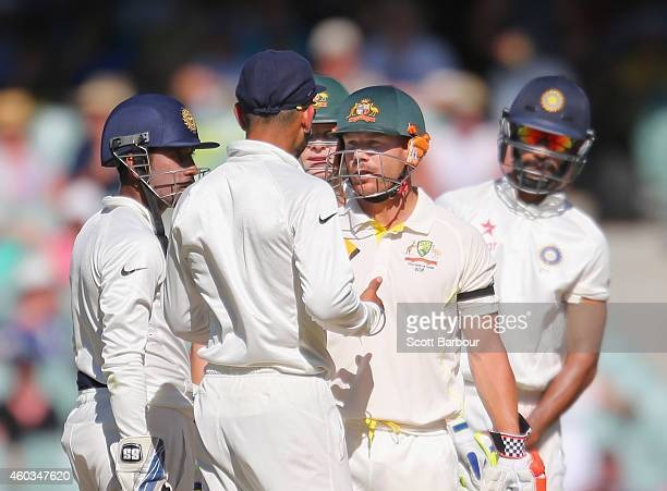David Warner of Australia and Virat Kohli of India exchange words as Wriddhiman Saha and Shikhar Dhawan of India and Steven Smith of Australia look...