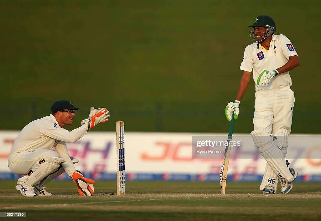 David Warner of Australia and Younis Khan of Pakistan share a joke during Day Three of the Second Test between Pakistan and Australia at Sheikh Zayed Stadium on November 1, 2014 in Abu Dhabi, United Arab Emirates.